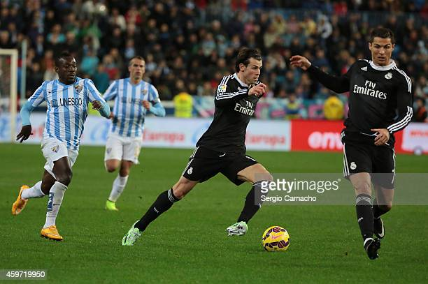 Gareth Bale and Cristiano Ronaldo of Real Madrid in action during the La Liga match between Malaga CF and Real Madrid CF at La Rosaleda studium on...