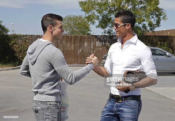 Gareth Bale and Cristiano Ronaldo of Real Madrid shake hands before a training session at Valdebebas training ground on September 11 2013 in Madrid...