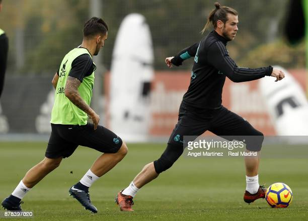 Gareth Bale and Dani Ceballos of Real Madrid in action during a training session at Valdebebas training ground on November 24 2017 in Madrid Spain