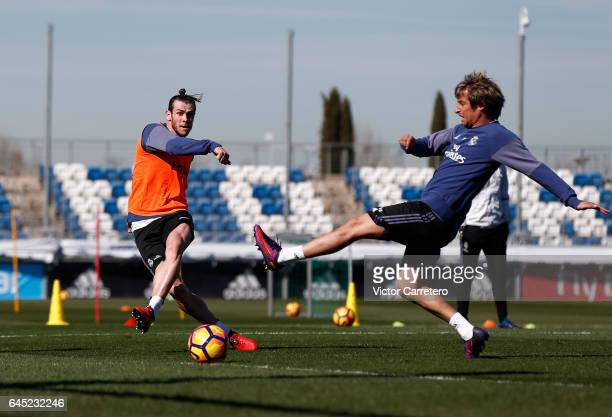 Gareth Bale and Fabio Coentrao of Real Madrid in action during a training session at Valdebebas training ground on February 25 2017 in Madrid Spain