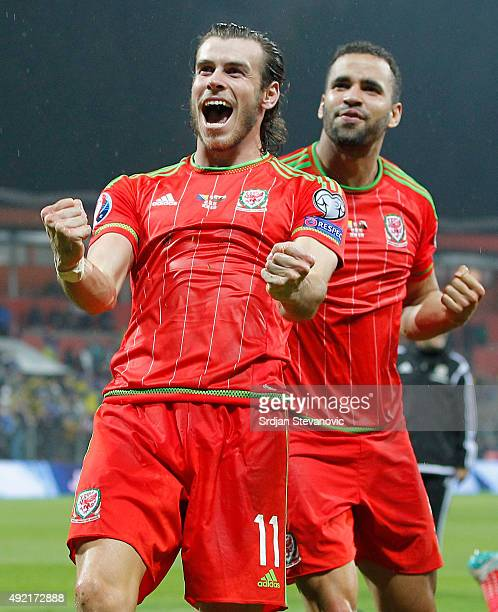 Gareth Bale and Hal RobsonKanu celebrate after the Euro 2016 qualifying football match between Bosnia and Herzegovina and Wales at the Stadium Bilino...
