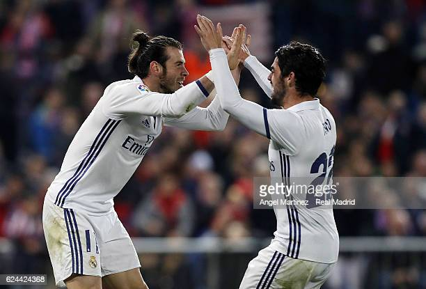 Gareth Bale and Isco of Real Madrid celebrate their team's third goal during the La Liga match between Club Atletico de Madrid and Real Madrid CF at...