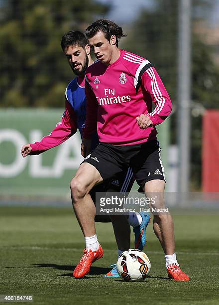 Gareth Bale and Isco of Real Madrid in action during a training session at Valdebebas training ground on March 14 2015 in Madrid Spain