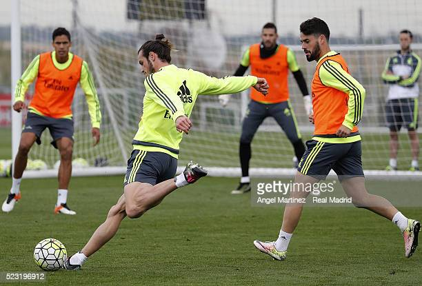 Gareth Bale and Isco of Real Madrid in action during a training session at Valdebebas training ground on April 22 2016 in Madrid Spain