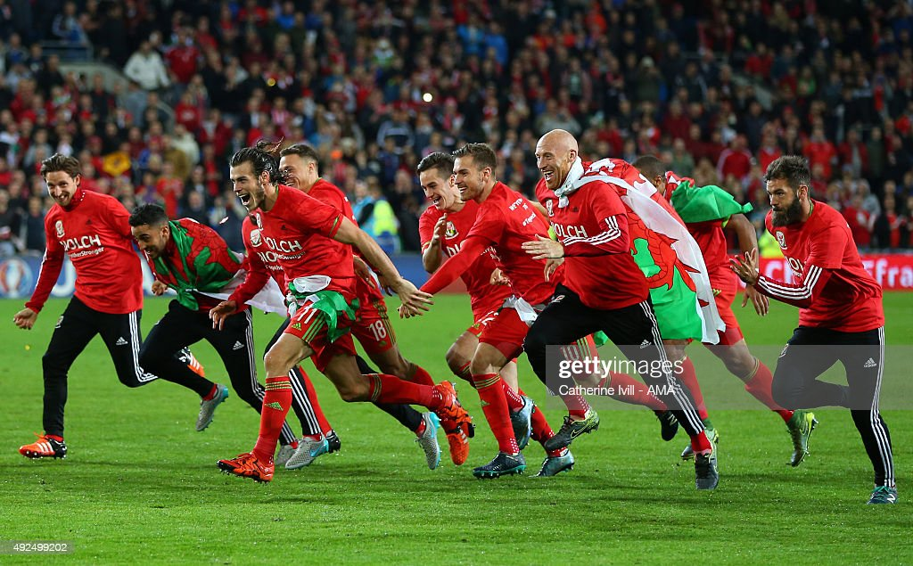 Gareth Bale and James Collins of Wales celebrate qualification with their team mates after the UEFA EURO 2016 Qualifier match between Wales and Andorra at Cardiff City Stadium on October 13, 2015 in Cardiff, United Kingdom.