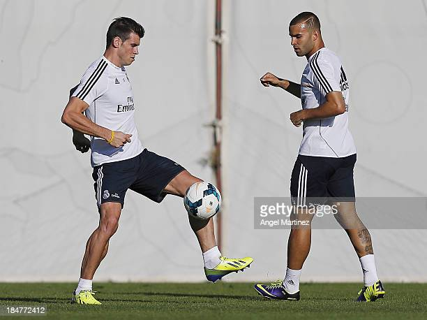 Gareth Bale and Jese Rodriguez of Real Madrid exercise during a training session at Valdebebas training ground on October 16 2013 in Madrid Spain