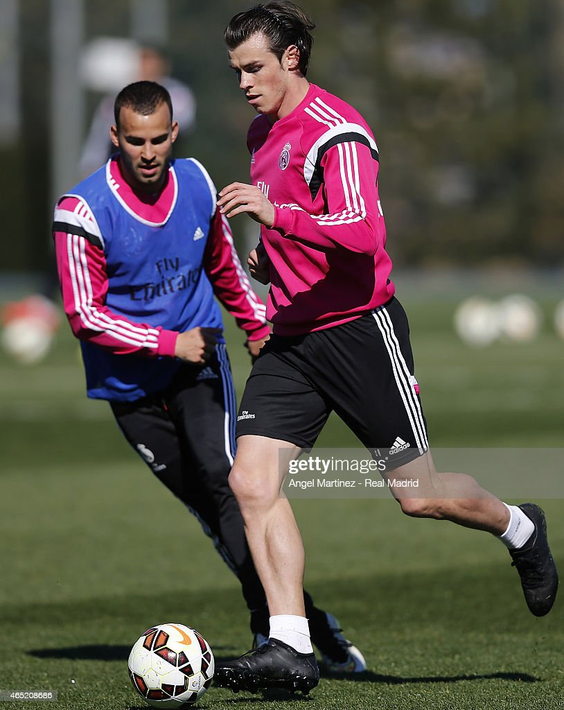 Gareth Bale (R) and Jese Rodriguez of Real Madrid in action during a training session at Valdebebas training ground on March 4, 2015 in Madrid, Spain.