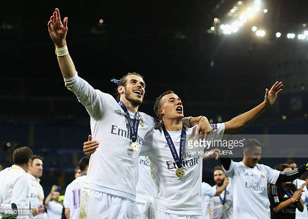 Gareth Bale and Lucas Vazquez of Real Madrid celebrate after the UEFA Champions League Final between Real Madrid and Club Atletico de Madrid at...