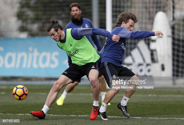 Gareth Bale and Luka Modric of Real Madrid in action during a training session at Valdebebas training ground on March 3 2017 in Madrid Spain