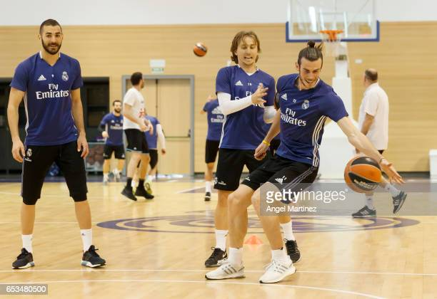 Gareth Bale and Luka Modric of Real Madrid in action during a training session at Ciudad Real Madrid basketball court on March 14 2017 in Madrid Spain