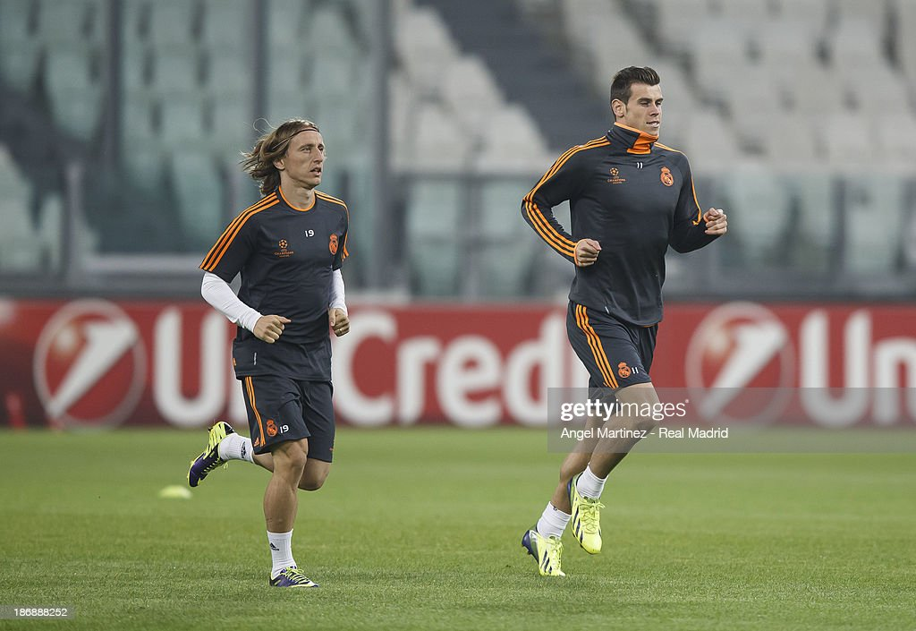 Gareth Bale (L) and Luka Modric of Real Madrid run during a training session ahead of their UEFA Champions League Group B match against Juventus at Juventus Arena on November 4, 2013 in Turin, Italy.