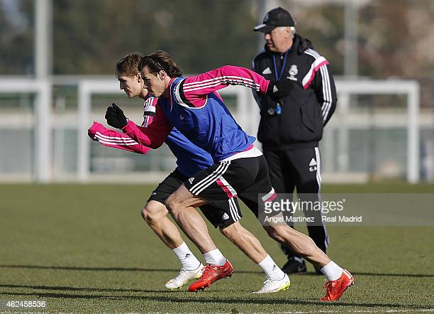 Gareth Bale and Martin Odegaard of Real Madrid run during a training session at Valdebebas training ground on January 29 2015 in Madrid Spain