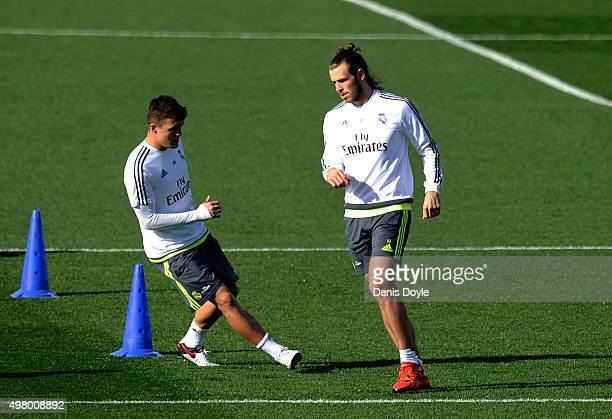 Gareth Bale and Mateo Kovacic of Real Madrid warmup during the Real Madrid training session ahead of the La Liga match between Real Madrid and...