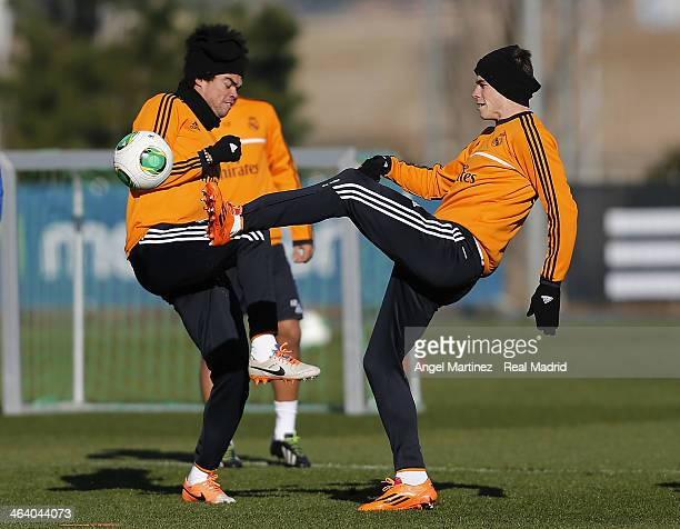 Gareth Bale and Pepe of Real Madrid in action during a training session at Ciudad Real Madrid on January 20 2014 in Madrid Spain