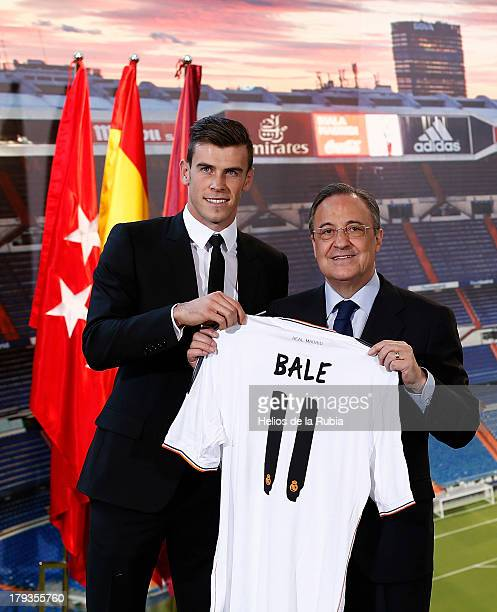 Gareth Bale and president Florentino Perez pose for the media during his official presentation as a new Real Madrid player at Estadio Santiago...