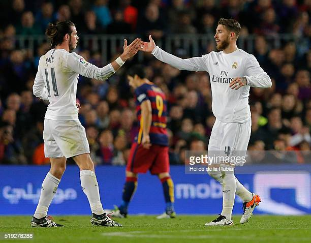 Gareth Bale and Sergio Ramos of Real Madrid celebrate after scoring during the La Liga match between FC Barcelona and Real Madrid CF at Camp Nou on...