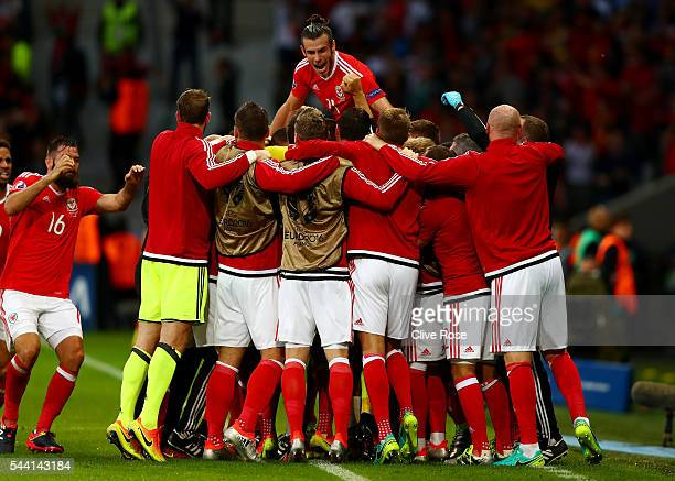 Gareth Bale and Wales players celebrate their team's first goal by Ashley Williams during the UEFA EURO 2016 quarter final match between Wales and...