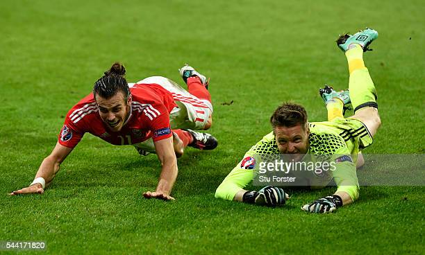 Gareth Bale and Wayne Hennessey of Wales celebrate their team's 31 win after the UEFA EURO 2016 quarter final match between Wales and Belgium at...