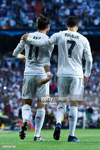 Gareth Bale celebrates with his teammate Cristiano Ronaldo of Real Madrid CF after scoring the opening goal during the UEFA Champions League Semi...