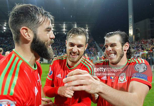 Gareth Bale celebrates with the team mates Aaron Ramsey and Joe Ledley after the Euro 2016 qualifying football match between Bosnia and Herzegovina...