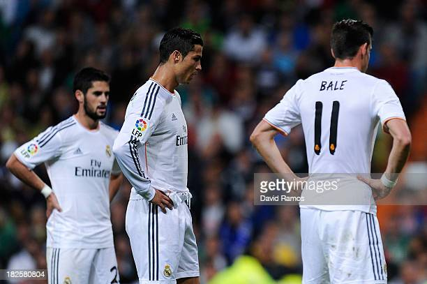 Gareth Bale Cristiano Ronaldo and Francisco Alarcon Isco of Real Madrid CF look on during the La Liga match between Real Madrid CF and Club Atletico...