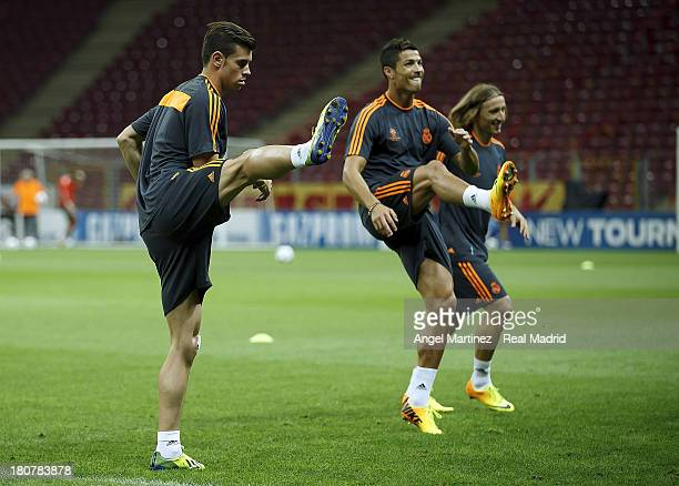 Gareth Bale Cristiano Ronaldo and Luka Modric of Real Madrid exercise during a training session ahead of their UEFA Champions League match against...