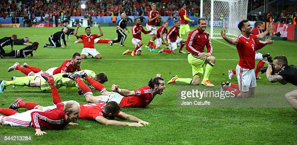 Gareth Bale Hal RobsonKanu of Wales and teammates celebrate the victory following the UEFA Euro 2016 quarter final match between Wales and Belgium at...
