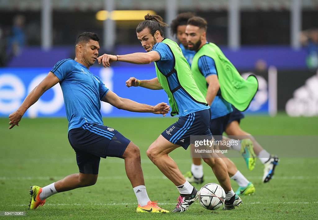 <a gi-track='captionPersonalityLinkClicked' href=/galleries/search?phrase=Gareth+Bale&family=editorial&specificpeople=609290 ng-click='$event.stopPropagation()'>Gareth Bale</a> is tackled by <a gi-track='captionPersonalityLinkClicked' href=/galleries/search?phrase=Casemiro&family=editorial&specificpeople=7150894 ng-click='$event.stopPropagation()'>Casemiro</a> of Real Madrid during a Real Madrid training session on the eve of the UEFA Champions League Final against Atletico de Madrid at Stadio Giuseppe Meazza on May 27, 2016 in Milan, Italy.