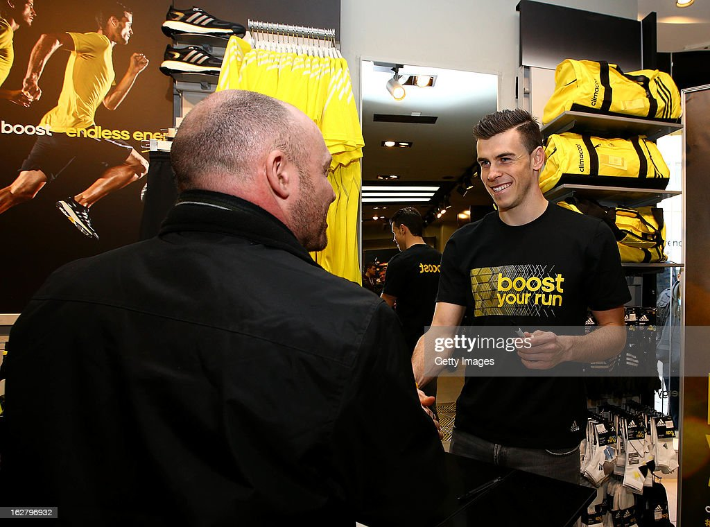 Gareth Bale meets and signs memorabilia for consumers during the adidas boost launch at the adidas store on Oxford Street on February 27, 2013 in London, England.