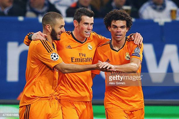 Gareth Bale of Madrid celebrates his team's fifth goal with team mates Karim Benzema and Pepe during the UEFA Champions League Round of 16 first leg...