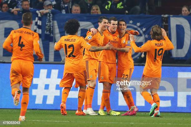 Gareth Bale of Madrid celebrates his team's second goal with team mates during the UEFA Champions League Round of 16 first leg match between FC...