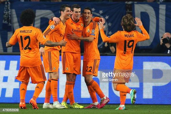 Gareth Bale of Madrid celebrates his team's second goal with team mates Marcelo Karim Benzema Angel Di Maria and Luka Modric during the UEFA...