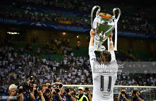 Gareth Bale of Madrid holds the winners trophy after the UEFA Champions League Final match between Real Madrid and Club Atletico de Madrid at Stadio...