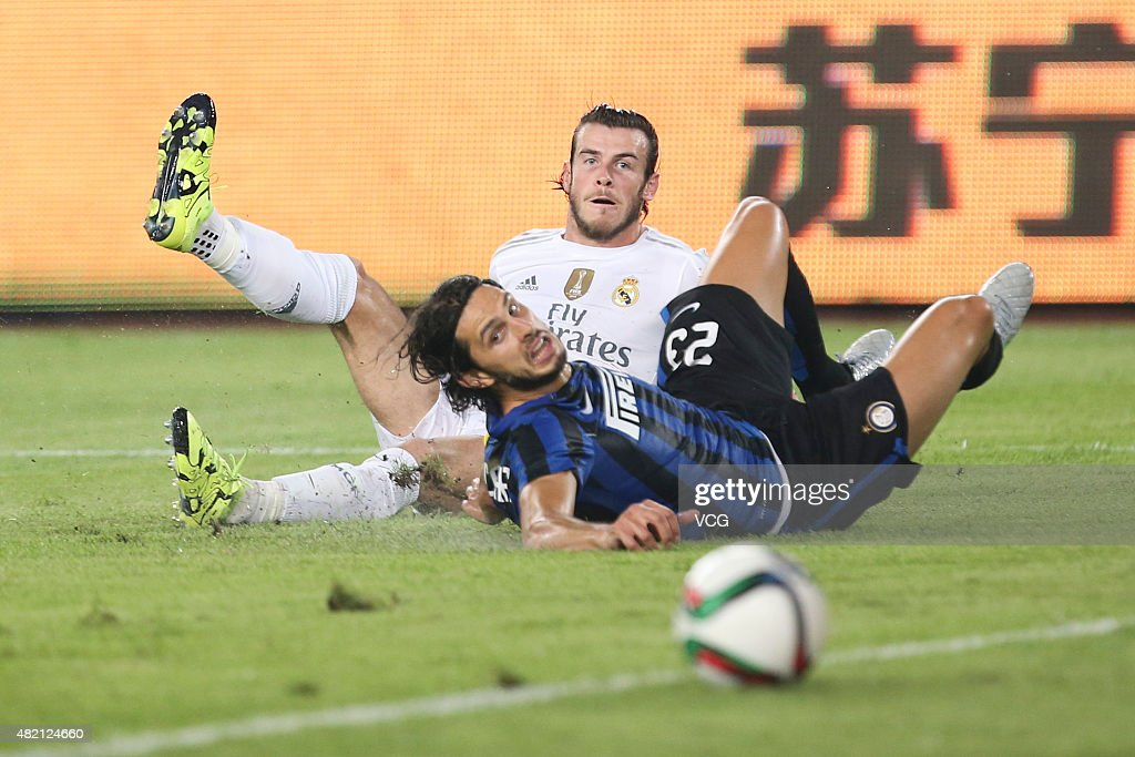 Gareth Bale #11 of Real Madrid and Andrea Ranocchia #23 of Inter Milan compete for the ball during the International Champions Cup football match between Inter Milan and Real Madrid at Tianhe Sports Center on July 27, 2015 in Guangzhou, China.