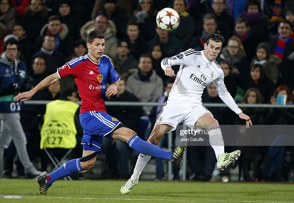 <a gi-track='captionPersonalityLinkClicked' href=/galleries/search?phrase=Gareth+Bale&family=editorial&specificpeople=609290 ng-click='$event.stopPropagation()'>Gareth Bale</a> of Real Madrid and Fabian Schar of FC Basel (left) in action during the UEFA Champions League Group B match between FC Basel 1893 and Real Madrid CF at St. Jakob-Park stadium on November 26, 2014 in Basel, Basel-Stadt, Switzerland.