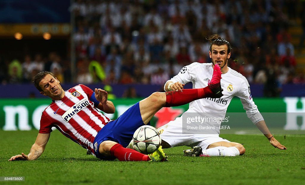 <a gi-track='captionPersonalityLinkClicked' href=/galleries/search?phrase=Gareth+Bale&family=editorial&specificpeople=609290 ng-click='$event.stopPropagation()'>Gareth Bale</a> of Real Madrid and <a gi-track='captionPersonalityLinkClicked' href=/galleries/search?phrase=Gabi+-+Futbolista&family=editorial&specificpeople=6912055 ng-click='$event.stopPropagation()'>Gabi</a> of Atletico Madrid compete for the ball during the UEFA Champions League Final between Real Madrid and Club Atletico de Madrid at Stadio Giuseppe Meazza on May 28, 2016 in Milan, Italy.