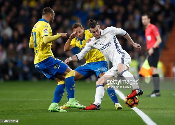 Gareth Bale of Real Madrid and Mauricio Lemos Jese Rodriguez of Las Palmas CD compete for the ball during the La Liga match between Real Madrid and...