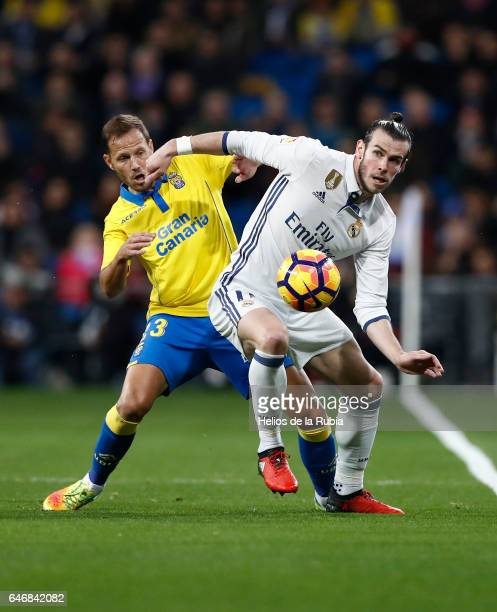 Gareth Bale of Real Madrid and Mauricio Lemos of Las Palmas CD compete for the ball during the La Liga match between Real Madrid and UD Las Palmas at...