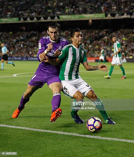 Gareth Bale of Real Madrid and Petros Matheus of Real Betis compete for the ball during the Spanish league football match Real Betis Balompie vs Real...