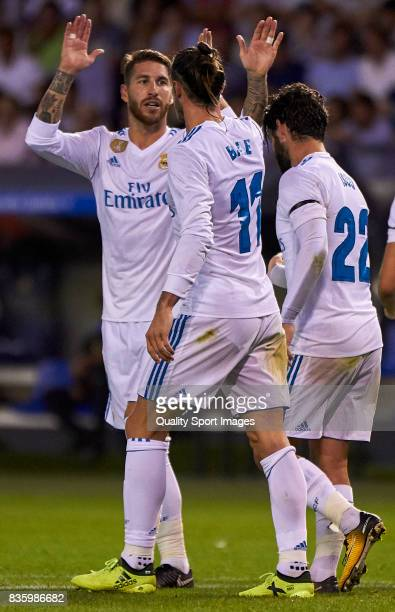 Gareth Bale of Real Madrid and Sergio Ramos of Real Madrid celebrate after scoring the third goal during the La Liga match between Deportivo La...