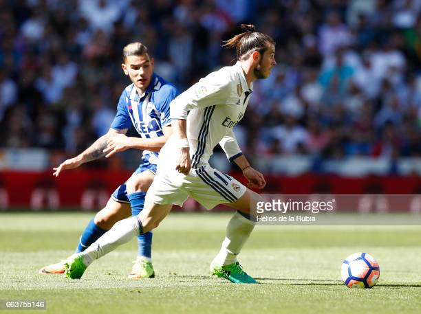 Gareth Bale of Real Madrid and Theo Hernandez of Deportivo Alaves compete for the ball during the La Liga match between Real Madrid and Real Betis...