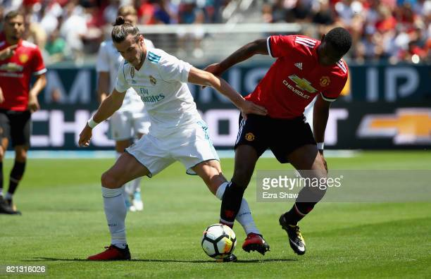 Gareth Bale of Real Madrid and Timothy FosuMensah of Manchester United go for the ball during the International Champions Cup match at Levi's Stadium...