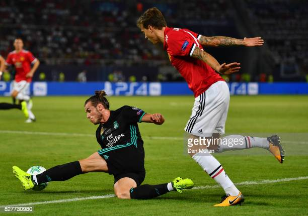 Gareth Bale of Real Madrid and Victor Lindelof of Manchester United battle for possession during the UEFA Super Cup final between Real Madrid and...