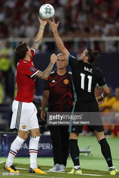 Gareth Bale of Real Madrid and Victor Lindelof of Manchester United trying to catch the ball while coach Jose Mourinho looks during the UEFA Super...