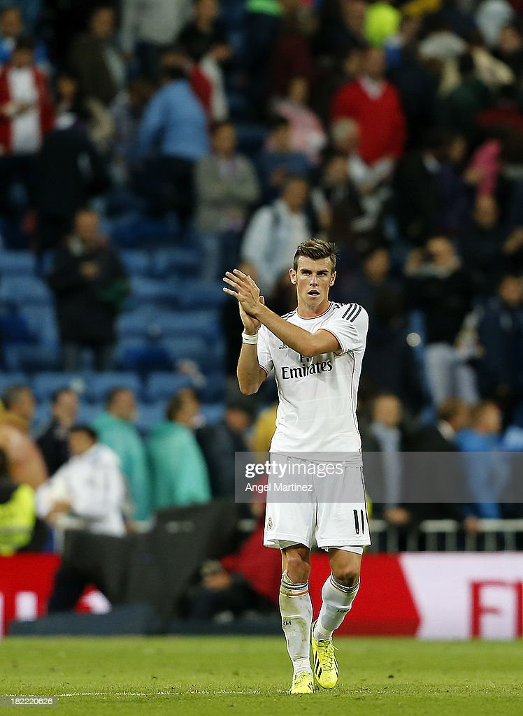 Gareth Bale of Real Madrid applauds ath the end of the La Liga match between Real Madrid and Club Atletico de Madrid at Estadio Santiago Bernabeu on September 28, 2013 in Madrid, Spain.