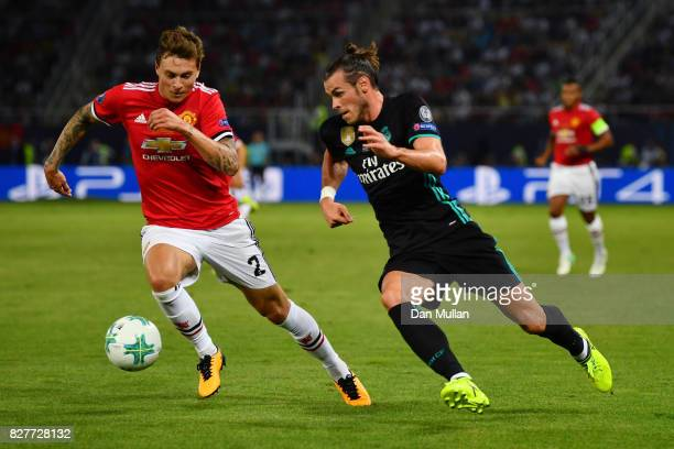 Gareth Bale of Real Madrid attempts to get past Victor Lindelof of Manchester United during the UEFA Super Cup final between Real Madrid and...