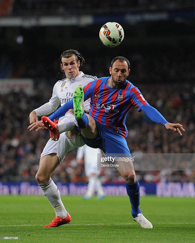 Gareth Bale of Real Madrid battles for the ball against Ivan Ramis of Levante UD during the La Liga match between Real Madrid CF and Levante UD at...