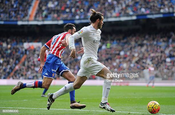Gareth Bale of Real Madrid beats Alex Menendez of Sporting Gijon during the La Liga match between Real Madrid CF and Sporting Gijon at Estadio...