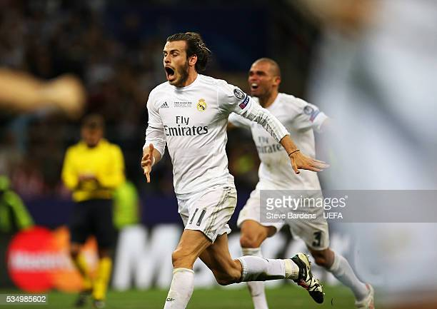 Gareth Bale of Real Madrid celebrates after Cristiano Ronaldo of Real Madrid scores the winning penalty in the shootout in the UEFA Champions League...
