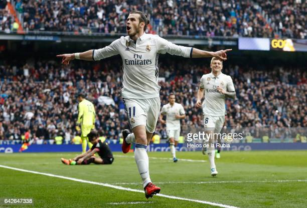 Gareth Bale of Real Madrid celebrates after scoring during the La Liga match between Real Madrid and RCD Espanyol at Estadio Santiago Bernabeu on...